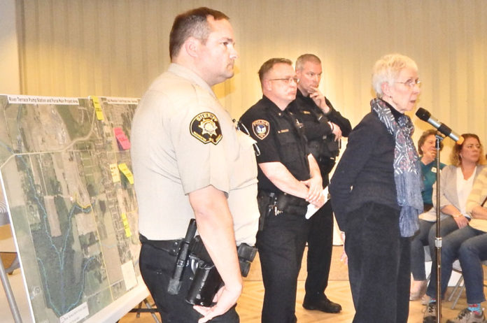 From left, Dave Shook from the Washington County Sheriff's Office, Neil Charlton from the Tigard Police Department, Pat Dean from the King City Police Department and Carol Herron with the St. Anthony severe weather shelter listen to an audience member's question at the March 19 joint meeting of Citizen Participation Organizations 4K (King City) and 4B (Bull Mountain/Tigard).