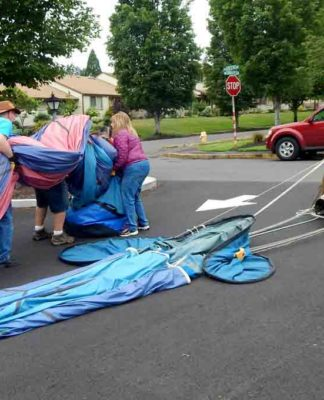 "After the inflated balloon was ""walked"" across Summerfield Drive to the Clubhouse parking lot and deflated, the crew rolled up the balloon and stuffed it into a canvas bag"