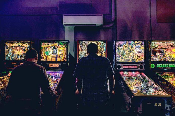 David Bartlett playing his favorite machines.