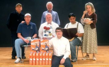 Cast in photo, left to right, back to front: Jim Coari; Kerry Kehoe; Lauri Monday; Mark Putnam; Dwayne Thurnau; Les Ico; Ted Schroeder.