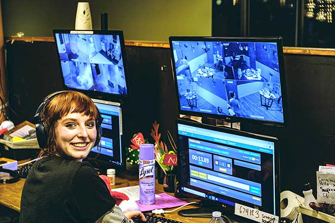 Just one of the many smiling faces who act as game master and run the show from the control room.
