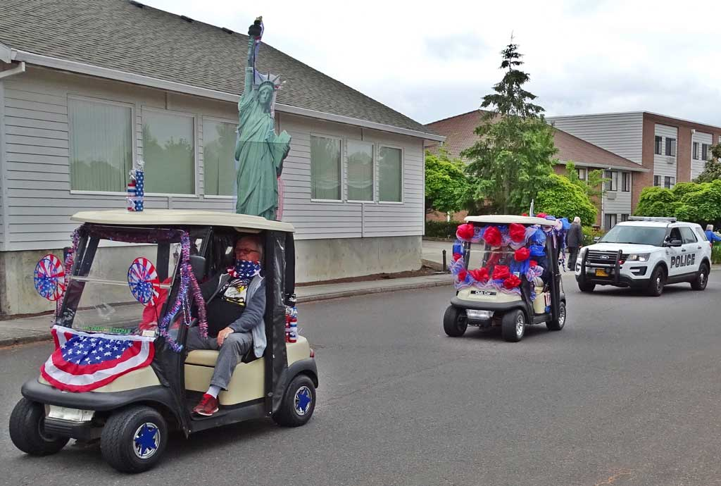 Will and Janet Craig led off the King City Fourth of July parade with Lady Liberty riding shotgun and Diana Pliler following in her golf cart loaded with decorations.