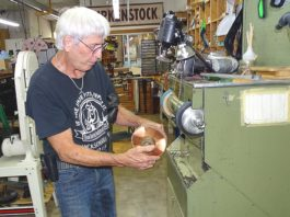 Don Myers operates a jack sander using a 24-grit carbide wheel in his Tigard shoe repair shop. Photos by Barbara Sherman.