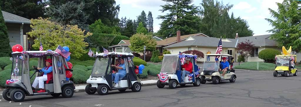The last golf carts in the Summerfield Fourth of July parade bring up the rear on Highland Drive.