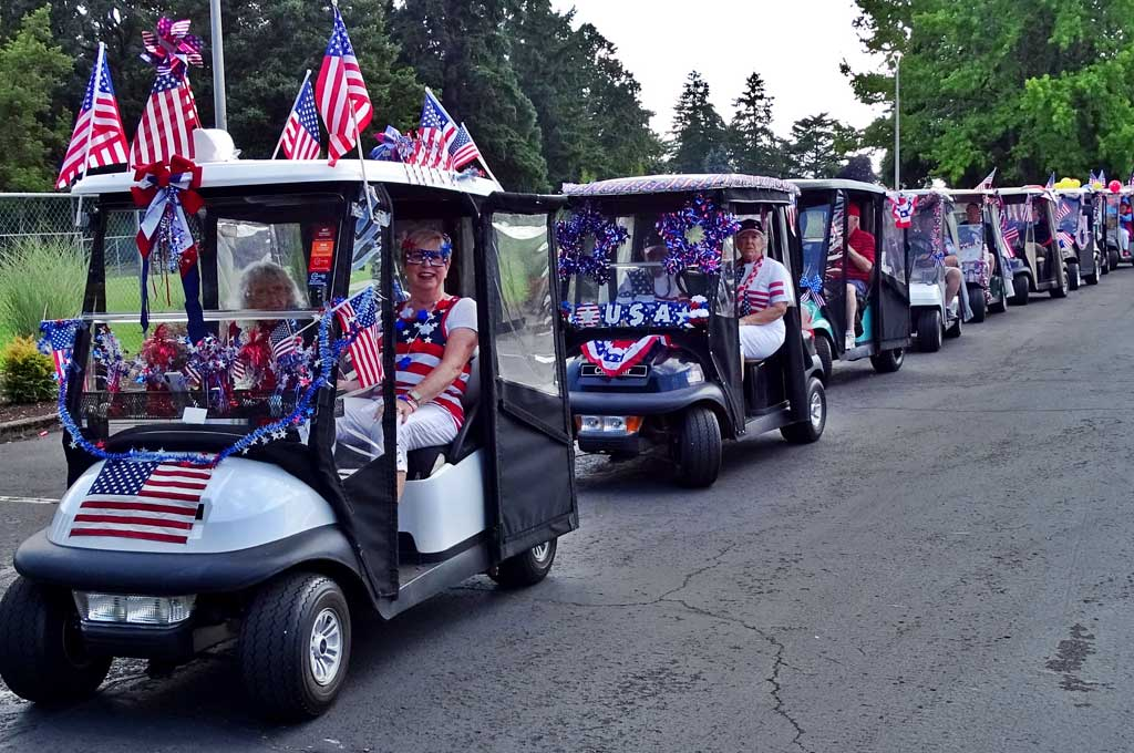 The Summerfield Fourth of July golf cart parade with Sandy Brewer in the lead cart is ready to hit the streets on the west side of 98th Avenue.