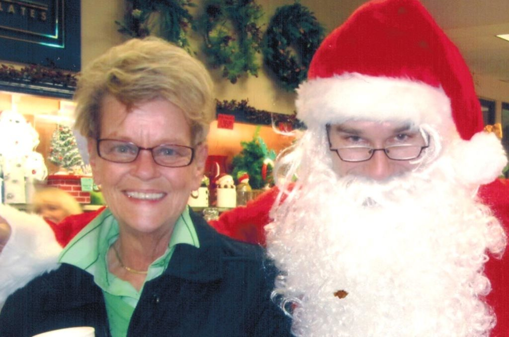 Nancy Norton (left) with Santa (Mat McCann) at a McCann's Pharmacy Christmas Party, 2010.                  Photo courtesy of Mat McCann.