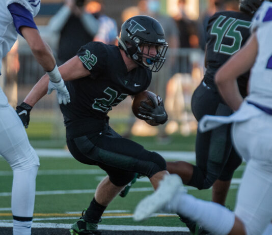 Tigard junior Konner Grant runs the ball in the first of the Tigers' 48-6 season opening loss to Sunset on Sept. 3, 2021, at Tigard High School.