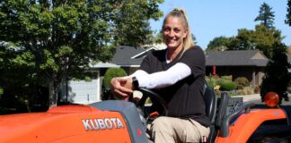 Carly Funicello drives a rough mower, one of several mowers at the Summerfield golf course.