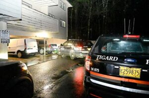 Tigard Police officers used their vehicles to box in Jacob Macduff's gray Nissan pickup truck.